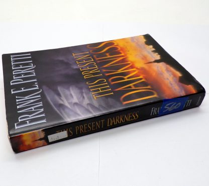 This Present Darkness Paperback by Frank E. Peretti